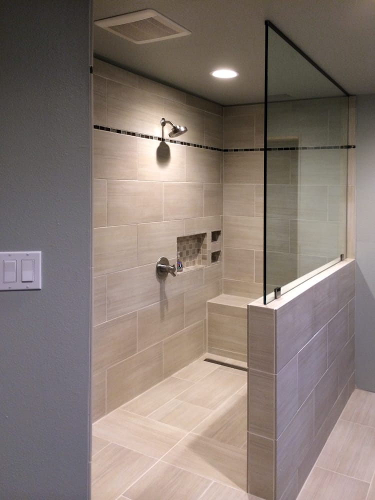 Shower Doors of Austin - Go Frameless Austin - showcases this stunning shower with pony wall & splash panel